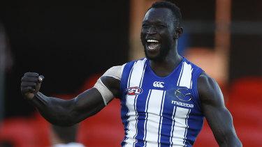 Majak Daw celebrates a goal during his triumphant AFL return.