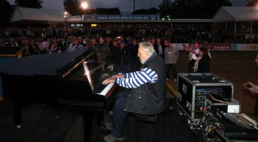 Life of the party: The late Geoff Harvey was in his element at TG Millner Field.