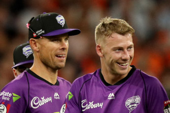 Riley Meredith (right) is a millionaire after the IPL auction.