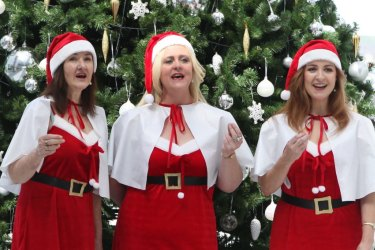 Hark! The Christmas carollers sing ... in masks with 'subdued voices'