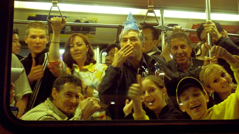 New Year's Eve revellers take a tram home.