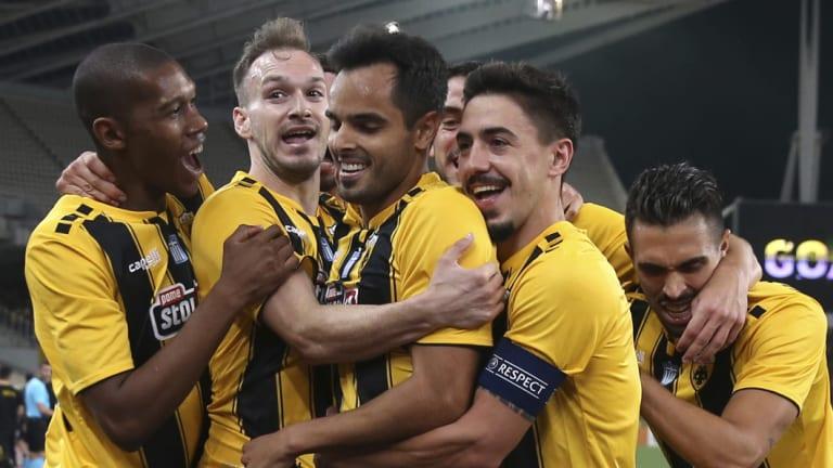 Big win: AEK Athens' Rodrigo Galo, centre, is congratulated after scoring.