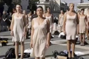 In this image taken from a video former Alitalia's flight attendants stage a protest in a square atop Rome's Capitoline Hill, Wednesday, Oct. 20, 2021. Dozens of former flight attendants from Alitalia, which went defunct this month, have stripped off their uniforms, remaining barefoot and only wearing undergarments, in a protest in central Rome. Long financially ailing, Italy's decades-old airline flew its last flight on Oct. 14.  A new airline, ITA, agreed, which has bought the Alitalia brand, is taking on fewer than 3,000 of Alitalia's 10,000 employees. (Federico Mariani/USB video via AP)