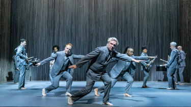 David Byrne (centre), and cast: the whole show is meticulously choreographed.