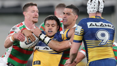Haze Dunster is wrapped up by the Rabbitohs during a tough NRL debut last season.