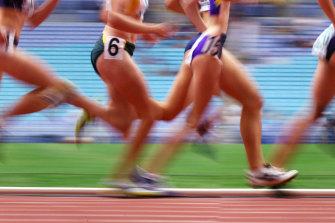 Athletes continue to train at a camp in Cairns, despite a staff member returning an inconclusive COVID test.