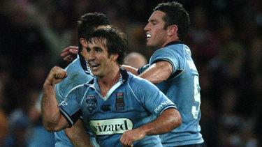 Rare breed: Andrew Johns celebrates victory in the 2005 State of Origin decider in Brisbane.