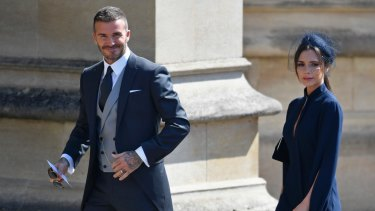 David and Victoria Beckham arrive for the wedding.