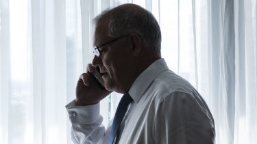 Scott Morrison on the phone to his wife Jenny during a break in his recent Brisbane campaign.