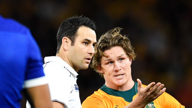 Michael Hooper and referee Ben O'Keeffe.