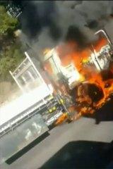 The Izuzu truck burst into flames buts its driver escaped injury.