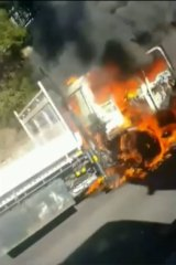 The Izuzu truck burst into flames buts its driver escaped injury.