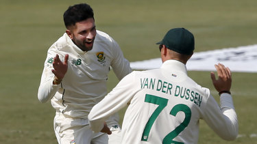 Keshav Maharaj, back, is just the second South African Test cricketer to take a hat-trick.