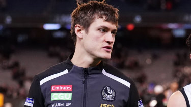Darcy Moore left the field after hurting his hamstring.