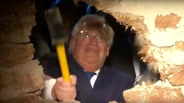 US Ambassador to Israel DavidFriedman uses a sledgehammer to smash the last remaining wall in front of the Pilgrimage Road at a ceremony in East Jerusalem.