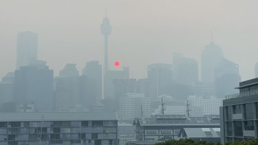 Sunrise over the Sydney CBD amid poor air quality due to bushfire smoke in December.