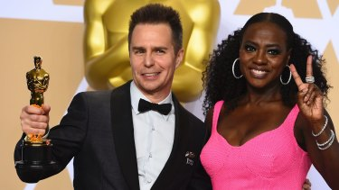 """Sam Rockwell (best supporting actor for his role in """"Three Billboards Outside Ebbing, Missouri"""") and Viola Davis at last year's Oscars ceremony.  The Hollywood glamour didn't reach disabled workers behind the scenes."""