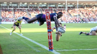 Flying high: Vunivalu gets airborne to score against the Dragons in 2017.