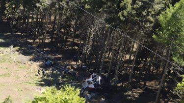 The wreckage of a cable car is seen on the ground after it collapsed.