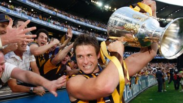 Dew celebrates Hawthorn's 2008 grand final win against the Cats.