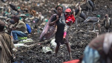 People scavenging for plastic at a garbage dump in the Dandora slum of Nairobi, Kenya, hunting for anything that can be recycled to earn themselves enough for their daily bread.