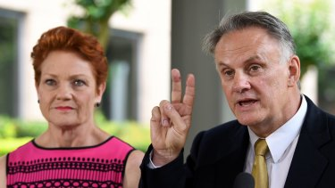 Peace in our times? Mark Latham with One Nation leader Pauline Hanson.
