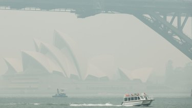 The thick smoke obscures Sydney's Opera House and Harbour Bridge.
