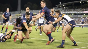 The Rebels' Jack Maddocks heads for the corner post against the Brumbies on Friday night.