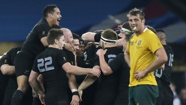 The All Blacks celebrate en route to their second consecutive World Cup title.