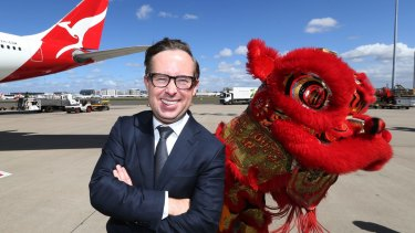 Qantas chief executive Alan Joyce pictured announcing the airline's return to Beijing in 2016.