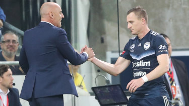 Strike force: Coach Kevin Muscat congratulates Besart Berisha for scoring the stunning late winner that sent Victory through to a semi-final clash against the Sky Blues.