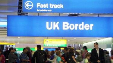 Passengers going through the UK Border at Terminal 2 of Heathrow Airport.