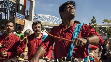 Australian Indians dancing and drumming in Sydney Olympic Park before Indian PM Narendra Modi arrives at a 2014 event.