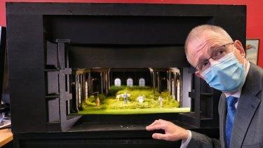 Federal Arts Minister Paul Fletcher looks over a model set at MTC.