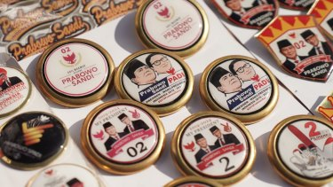 "Buttons featuring Prabowo and his running mate Sandiaga ""Sandi"" Uno at a campaign rally in Karawang, West Java."