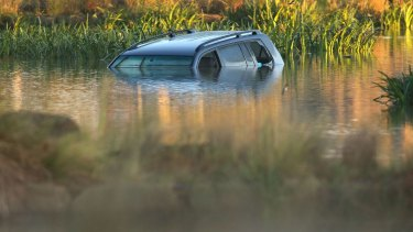 Akon Guode's car in the lake.