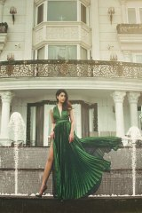 Jacqueline Nguyen outside the family mansion in Ho Chi Minh city in a photoshoot for Vietnamese magazine L'Officiel.
