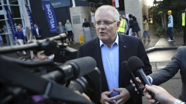 Divine intervention: Re-elected Prime Minister Scott Morrison arrives at the Horizon Church in Sutherland on Sunday.