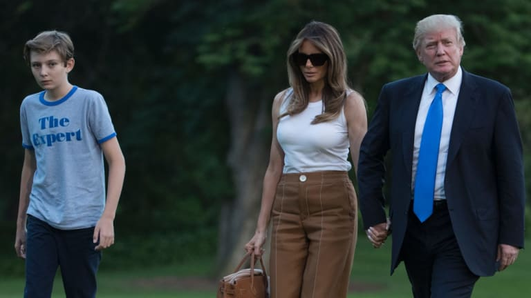 Donald and Melania Trump with their son Barron outside the White House.