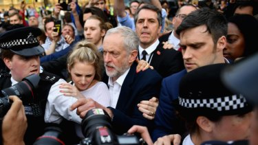 Corbyn arrives to deliver a speech during Momentum's 'Keep Corbyn' rally in 2016.