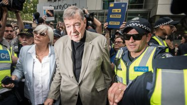 Cardinal George Pell leaving the County Court where was found guilty of child sexual offences.