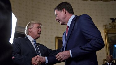President Donald Trump greets then-FBI director James Comey with a handshake back in January, 2017.