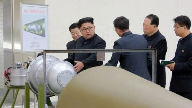 Image distributed on Sunday allegedly of North Korean leader Kim Jong-Un inspecting the loading of a hydrogen bomb into an intercontinental ballistic missile.