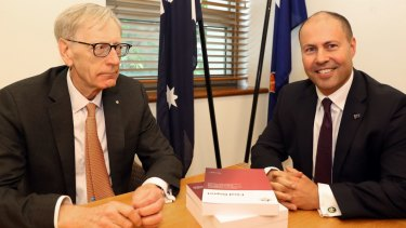 Commissioner Kenneth Hayne delivers his report to Treasurer Josh Frydenberg.