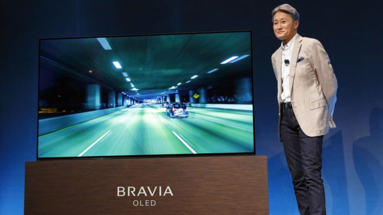 Sony boss Kazuo Hirai with a 4K TV in 2017.