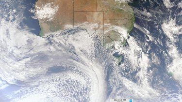 A satellite image showing a cold front crossing south-eastern Australia on Monday morning, with another front approaching Australia from the Southern Ocean.