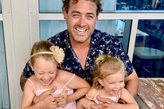 Luca McIlroy with her dad Scott and sister Emmy.