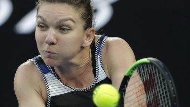 Simona Halep fought back after losing the first set but was unable to overcome a powerful Williams.