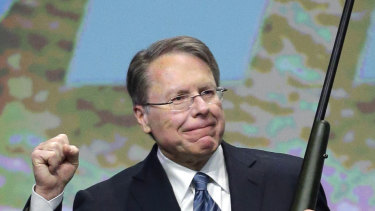 Wayne LaPierre, executive vice-president of the National Rifle Association, holds a custom 300 Remington ultra mag during a gun auction in 2013.