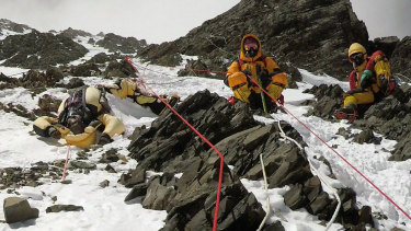 Two sherpas retrieve the body of Indian climber Goutam Ghosh (left) in May 2017. He had died near the summit a year earlier.